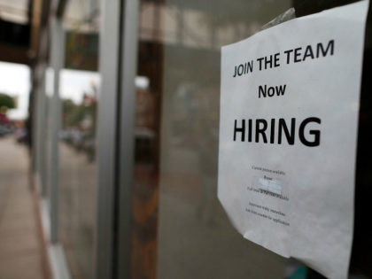 "In this Wednesday, July 18, 2018, photograph, a ""now hiring"" sign hangs in the window of a Chinese restaurant in downtown Fargo, N.D. Data shows that small businesses are hiring less, despite the strong economy, partly because they are losing employees to bigger firms. (AP Photo/David Zalubowski)"