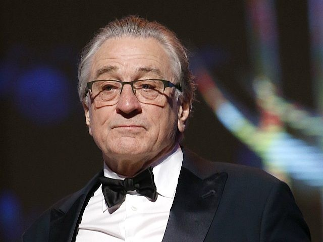 Robert De Niro poses for photographers after receiving a tribute to his contribution to acting, during the 17th Marrakech International Film Festival in Marrakech, Morocco, Saturday, Dec. 1, 2018. The festival runs from Nov. 30 - Dec. 8. (AP Photo/Abdeljalil Bounhar)