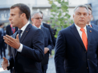 Hungary's Prime Minister Viktor Orban (R) and France's President Emmanuel Macron arrive at the Mozarteum University to attend a plenary session part of the EU Informal Summit of Heads of State or Government in Salzburg, Austria, on September 20, 2018. (Photo by GEORG HOCHMUTH / APA / AFP) / Austria …