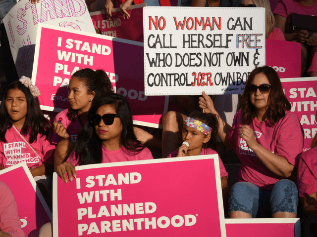 Supporters and patients of Planned Parenthood take part in a 'Pink the Night Out' rally at City Hall, which is part of a nationwide series of actions in support of the organization and in opposition to US President Donald Trump's health care proposal, in Los Angeles, California on June 21, …