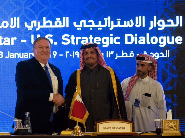 US Secretary of State Mike Pompeo (L) signs an MOU and statement of intent with Mohammed bin Abdulrahman bin Jassim Al Thani, the Deputy Prime Minister and Qatari Minister of Foreign Affairs, at the Sheraton Grand in the Qatari capital Doha on January 13, 2019. (Photo by ANDREW CABALLERO-REYNOLDS / …