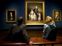 Visitors look at paintings 'The Duke of Osuna around 1795' (L), 'The Duke and Duchess of Osuna and their Children 1788' (C), and 'The Countess-Duchess of Benavente 1785 by Spanish artist Francisco de Goya during a press preview of 'Goya, The Portraits' at the National Gallery in London on October …