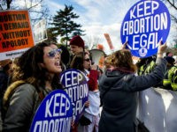 Pro-choice activists block the road against US Capitol Police, who are escorting the March For Life's path, in front of the US Supreme Court in Washington, DC, January 22, 2015. Tens of thousands of Americans who oppose abortion are in Washington for the annual March for Life, marking the 42nd …