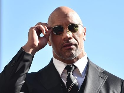 HOLLYWOOD, CA - DECEMBER 13: Actor Dwayne Johnson attends a ceremony honoring him with the 2,624th star on the Hollywood Walk of Fame on December 13, 2017 in Hollywood, California. (Photo by Alberto E. Rodriguez/Getty Images)