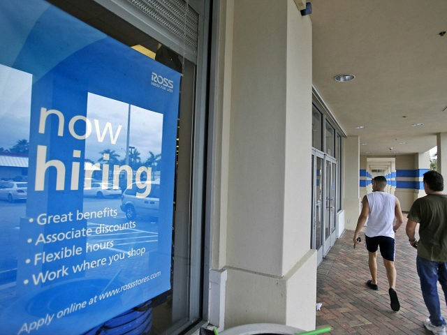 FILE - In this May 16, 2014 file photo, shoppers walk past a now hiring sign at a Ross store in North Miami Beach, Fla. The Labor Department releases weekly jobless claims on Thursday, Sept. 10, 2015. (AP Photo/Wilfredo Lee, File) unemployment
