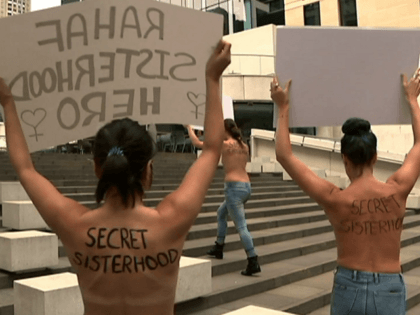SYDNEY (AP) — Four women held a topless protest in Sydney on Thursday to support runaway Saudi woman Rahaf Mohammed Alqunun, as Australia began considering her bid to settle in the country as a refugee.