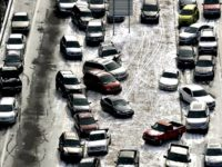 In this Jan. 29, 2014 aerial file photo, abandoned cars at I-75 headed northbound near the Chattahoochee River overpass are piled up in the median of the ice-covered interstate after a winter snow storm, in Atlanta. A winter storm watch goes into effect at 4 a.m. Tuesday, Jan. 29, for …