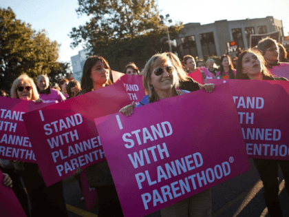 HEMPSTEAD, NY - OCTOBER 16: Women protest for continued funding of Planned Parenthood outside Hofstra University prior to the second presidential debate on October 16, 2012 in Hempstead, New York. U.S. President Barack Obama and Republican presidential candidate Mitt Romney will debate in a town hall style meeting this evening …