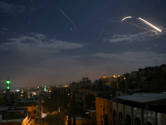 A picture taken early on January 21, 2019 shows Syrian air defence batteries responding to what the Syrian state media said were Israeli missiles targeting Damascus. - Israel struck what it said were Iranian targets in Syria today in response to rocket fire it blamed on Iran, sparking concerns of …