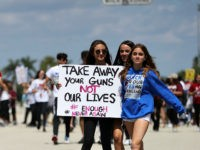 PARKLAND, FL - MARCH 24: Marjory Stoneman Douglas High School students participate in the March For Our Lives event at Pine Trails Park as they walk to the high school on March 24, 2018 in Parkland, Florida. The event was one of many scheduled around the United States calling for …
