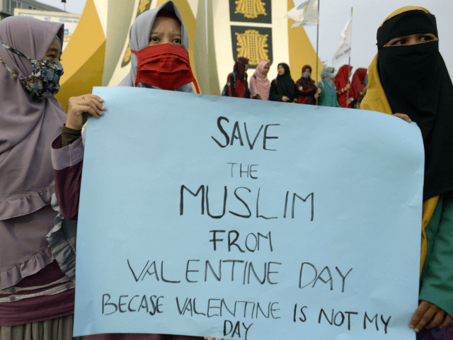 Indonesian Muslim students hold a protest against Valentine's Day in Banda Aceh on February 14, 2018. Valentine's Day was banned in some Indonesian cities on February 14 as police rounded up amorous couples, giving the official kiss-off to a tradition which critics say doesn't deserve any love in the Muslim-majority …