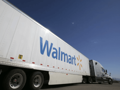 A Wal-Mart Stores Inc. tractor trailer truck departs the company's distribution center in Washington, Utah, U.S., on Friday, Sept. 23, 2016. The International Council of Shopping Centers is scheduled to release U.S. chain store sales figures on October 6. Photographer: George Frey/Bloomberg via Getty Images