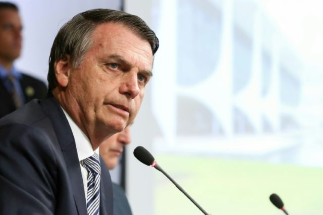 Bolsonaro rushes through changes to Brazil