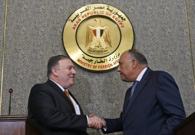 US Secretary of State Mike Pompeo shakes hands after holding a press conference with Egyptian Foreign Minister Sameh Shoukry at the ministry of foreign affairs in Cairo