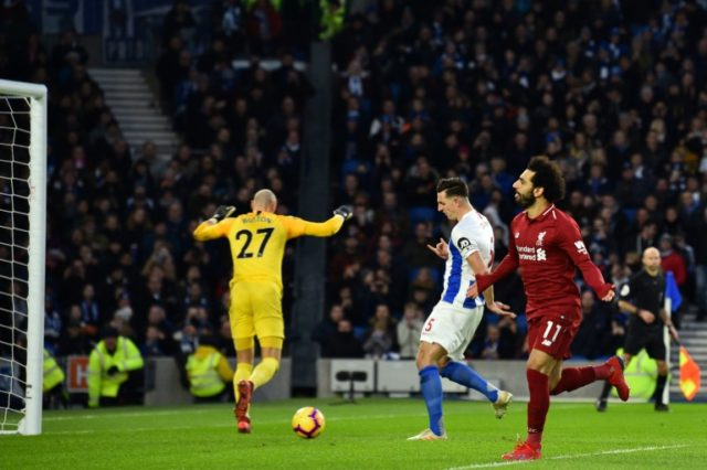 Salah penalty sends Liverpool seven points clear again