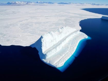 This file NASA image released in December 2017 by Operation IceBridge during a flight to Victoria Land shows an iceberg floating in Antarctica's McMurdo Sound -- global warming is melting ice in Antarctica faster than ever before, a new study says