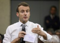 Choose France? Macron woos business chiefs rattled by protests
