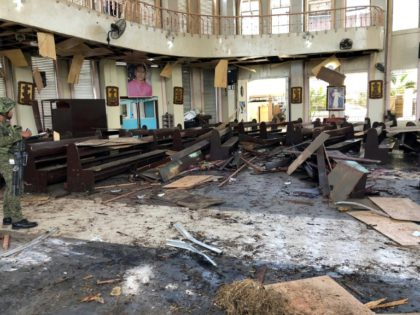 At least 18 killed in twin bomb attack on Philippine church