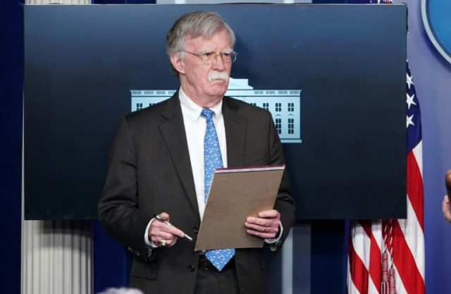 Bolton holds notepad saying: '5,000 troops to Colombia'