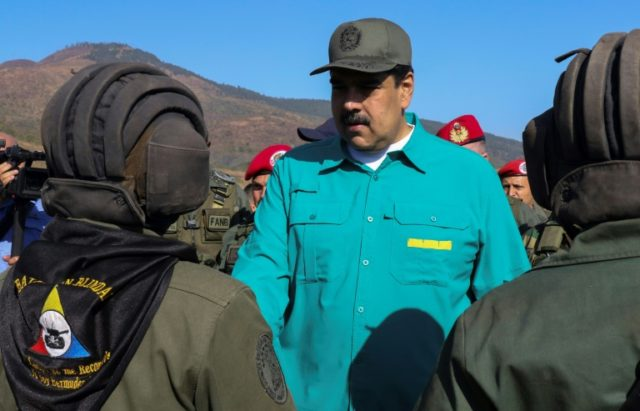 Venezuela's Nicolas Maduro (C) has sought to maintain the loyalty of the military