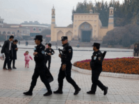 Security personnel near the Id Kah Mosque in Kashgar, in the Xinjiang region of China. Hundreds of thousands of Muslims in Xinjiang have been held in a network of indoctrination camps.CreditCreditNg Han Guan/Associated Press