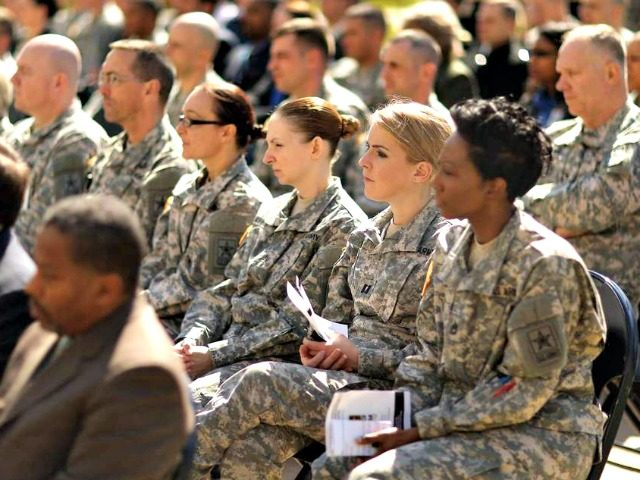 Soldiers, officers and civilian employees attend the commencement ceremony for the US Army's annual observance of Sexual Assault Awareness and Prevention Month in the Pentagon Center Courtyard in 2015 in Arlington, Virginia