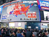 People watch election returns in Times Square on election night in 2016. After the exit polls appeared to be significantly off in that election, Fox News and the AP broke with other news organizations to start a new system. That could mean competing narratives of what happens on Election Day.