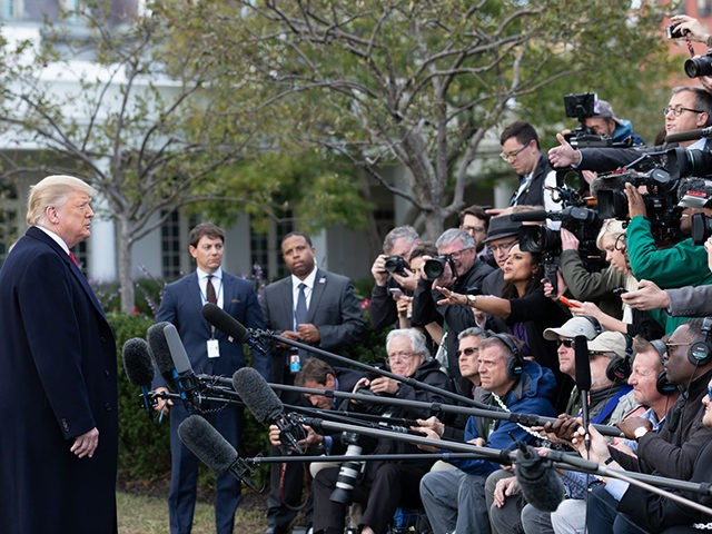 President Donald J. Trump talks with reporters along the South Lawn of the White House Wednesday, Oct. 31, 2018, prior to boarding Marine One to begin his trip to Fort Myers, Fla. (Official White House Photo by Joyce N. Boghosian)