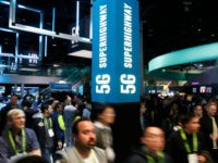 A sign advertises 5G devices at the Intel booth during CES International, Tuesday, Jan. 9, 2018, in Las Vegas. (AP Photo/John Locher)