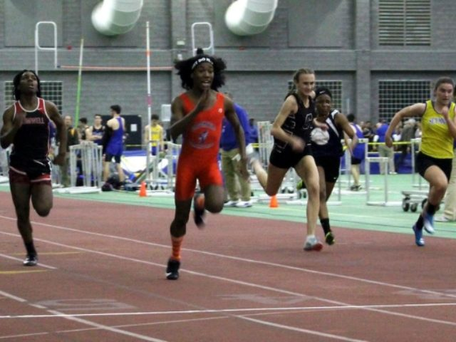 In this Thursday, Feb. 7, 2019 photo, Bloomfield High School transgender athlete Terry Miller, second from left, wins the final of the 55-meter dash over transgender athlete Andraya Yearwood, left, and other runners in the Connecticut girls Class S indoor track meet at Hillhouse High School in New Haven, Conn. …
