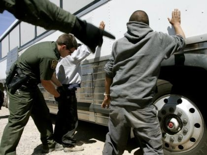 Border Patrol agents arrest illegal aliens in Arizona. (AP File Photo/Khampha Bouaphanh)