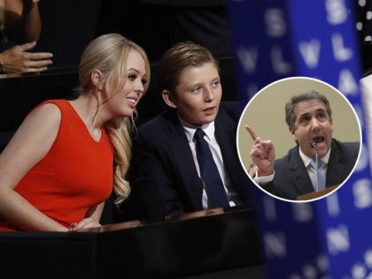 (INSET: Michael Cohen) Barron Trump, center, son of Donald and Melania Trump, talks to Tiffany Trump as Melania Trump sits at right during the final day of the Republican National Convention in Cleveland, Thursday, July 21, 2016. (AP Photo/Paul Sancya)