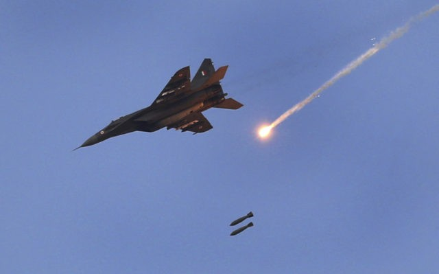 An Indian Air Force (IAF) MIG 29 releases bombs during an air exercise named 'Vayu Shakti-2019', or air power, at Pokhran, in the western Indian state of Rajasthan, Saturday, Feb. 16, 2019. The IAF carried out an exercise near the border with Pakistan, showcasing indigenously-developed Light Combat Aircraft (LCA) Tejas, …