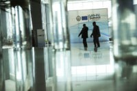 Security guards walk along the main hall of the Sharm El Sheikh convention centre in Sharm El Sheikh, Egypt, Saturday, Feb. 23, 2019. Leaders from the European Union and Arab countries are holding their first-ever summit aimed at deepening ties on migration, security and trade. (AP Photo/Francisco Seco)