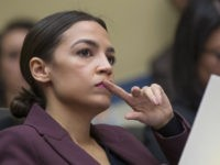 Rep. Alexandria Ocasio-Cortez, D-N.Y., listens to questions as Michael Cohen, President Donald Trump's former personal lawyer, testifies before the House Oversight and Reform Committee, on Capitol Hill, Wednesday, Feb. 27, 2019, in Washington. (AP Photo/Alex Brandon)