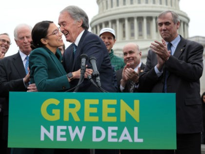 U.S. Rep. Alexandria Ocasio-Cortez (D-NY) (L) and Sen. Ed Markey (D-MA) (R) hug each other as other Congressional Democrats look on during a news conference in front of the U.S. Capitol February 7, 2019 in Washington, DC. Sen. Markey and Rep. Ocasio-Cortez held a news conference to unveil their Green …