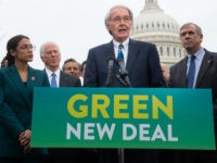 US Representative Alexandria Ocasio-Cortez, Democrat of New York, and US Senator Ed Markey (C), Democrat of Massachusetts, speak during a press conference to announce Green New Deal legislation to promote clean energy programs outside the US Capitol in Washington, DC, February 7, 2019. (Photo by SAUL LOEB / AFP) (Photo …