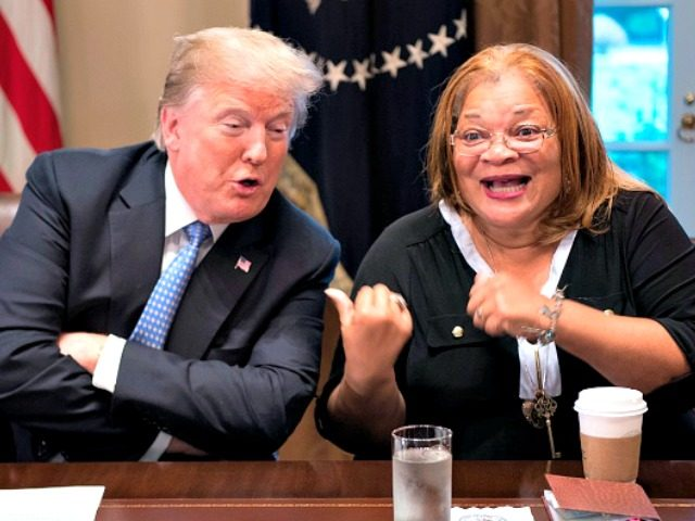 US President Donald Trump responds to Dr. Alveda King, niece of Dr. Martin Luther King Jr., during a meeting with inner city pastors at the White House in Washington, DC,on August 1, 2018. - President Trump delivered remarks at the roundtable discussion with several inner city pastors, and discussed the …