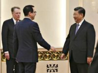 U.S. Treasury Secretary Steven Mnuchin, second from left, talks with Chinese President Xi Jinping, second from right, on Friday at the Great Hall of the People in Beijing. They are joined by U.S. Trade Representative Robert E. Lighthizer, left, and Chinese Vice Premier Liu He. (Andy Wong/AFP/Getty Images)