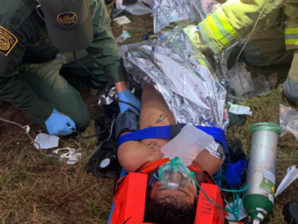 Laredo Sector Border Patrol agents provide medical assistance to an illegal alien who was struck by a truck while attempting to circumvent an immigration checkpoint. (Photo: U.S. Border Patrol/Laredo Sector)