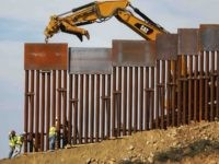 Border fence construction (Mario Tama / Getty)