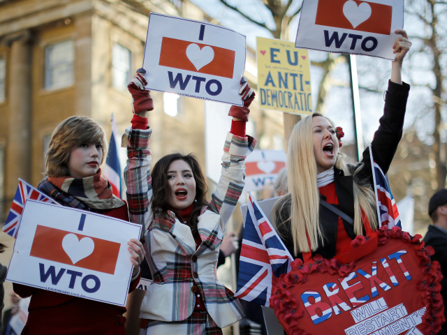 Pro-Brexit activists hold placards and wave flags as they demonstrate opposite Downing Street in central London on February 14, 2019. - Prime Minister Theresa May risks another humiliating Brexit defeat at the hands of her own eurosceptic MPs on Thursday, with just weeks to go until Britain officially leaves the …