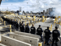 Large Group of Migrants Rush International Bridge Assault CBP Officers