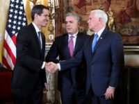 Venezuela's self-proclaimed interim president Juan Guaido, left, shakes with Vice President Mike Pence, after a meeting of the Lima Group concerning Venezuela at the Foreign Ministry in Bogota, Colombia, Monday, Feb. 25, 2019. Pence's appearance before the Lima Group comes two days after a U.S.-backed effort to deliver humanitarian across …
