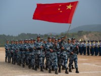Chinese People's Liberation Army Air Force (PLAAF) personnel marching with their national flag during the opening ceremony of the International Army Games 2017 in Guangshui in China's central Hubei province.