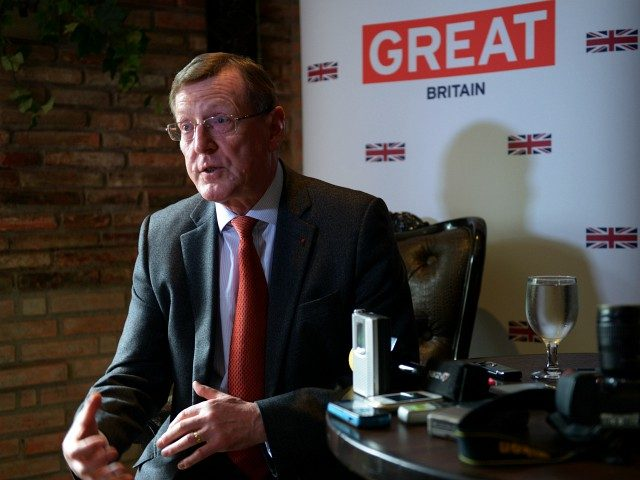 Northern Irish Nobel Peace Prize laureate Lord David Trimble gestures as he discusses efforts to negotiate a peace accord between the Philippine government and the Moro Islamic Liberation Front (MILF) in the south during a press briefing in Manila on November 16 2012. Trimble will travel to the troubled southern …