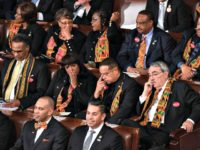 Members of Congress wear black clothing and Kente cloth in protest as US President Donald Trump delivers the State of the Union address in Washington, D.C.