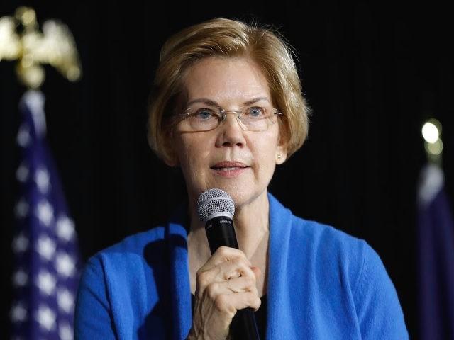 Sen. Elizabeth Warren, D-Mass., speaks to local residents during an organizing event, Sunday, Feb. 10, 2019, in Cedar Rapids, Iowa.