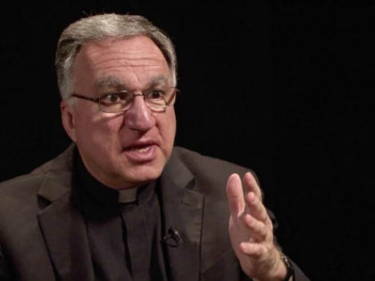 Father Thomas Rosica with hand gesture
