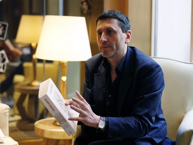 "French writer Frederic Martel gestures during an interview with Associated Press, in Paris, Friday, Feb. 15, 2019. In the explosive book ""In the Closet of the Vatican"" author Frederic Martel describes a gay subculture at the Vatican and calls out the hypocrisy of Catholic bishops and cardinals who in public …"